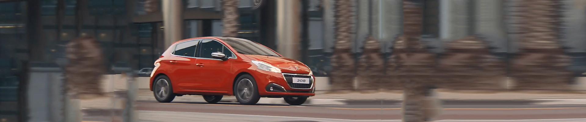 Peugeot 208 Allure Premium in Orange Power